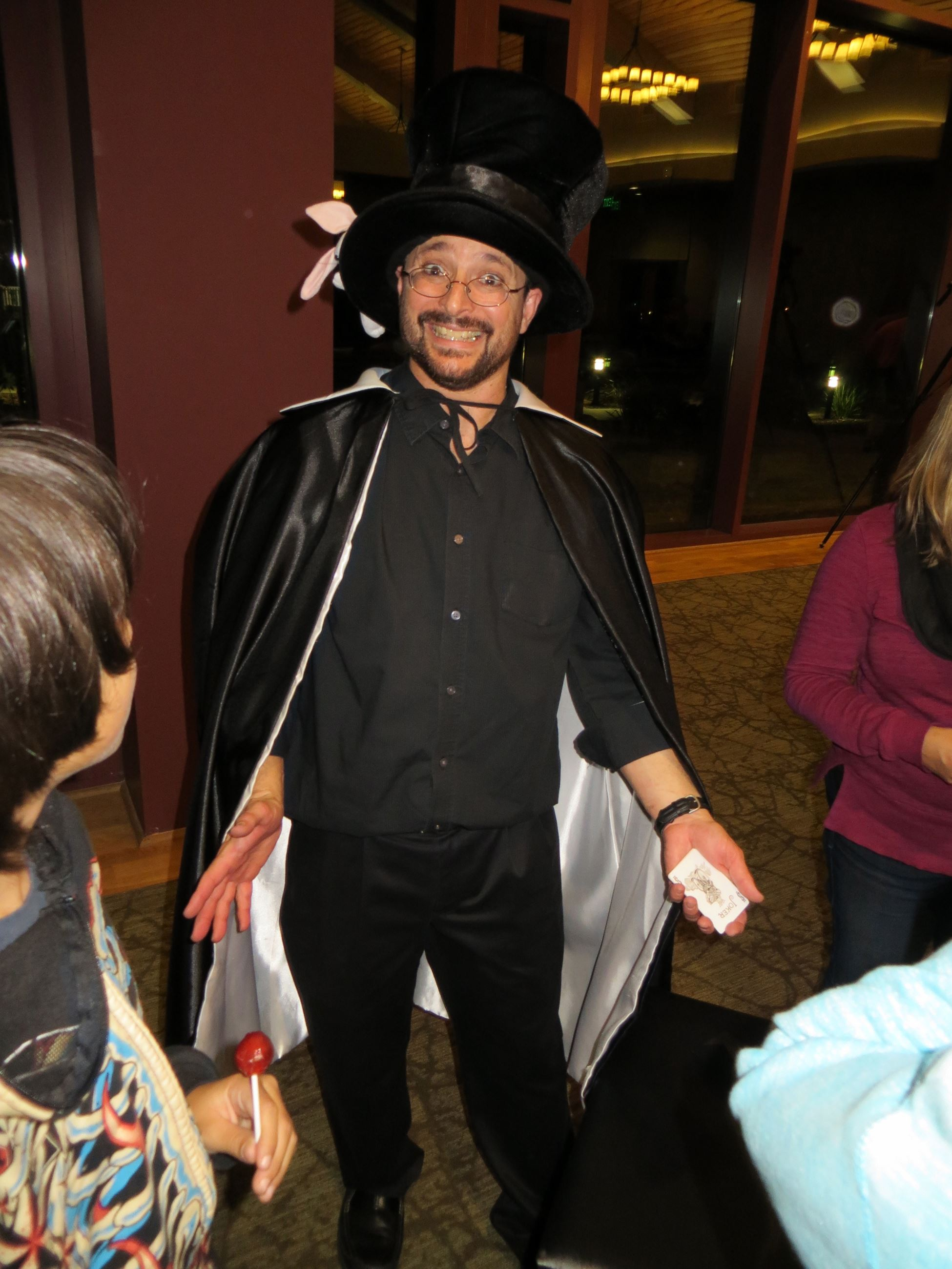 Smiling Magician in Black Cape