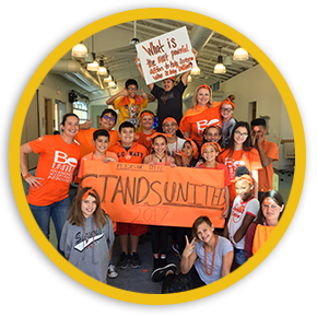 Group of Teens wearing orange and holding up Unity Day anti-bullying signs