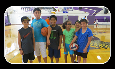 Group of boys and girls holding basketballs