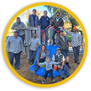 Group photo of District park staff on preschool playground