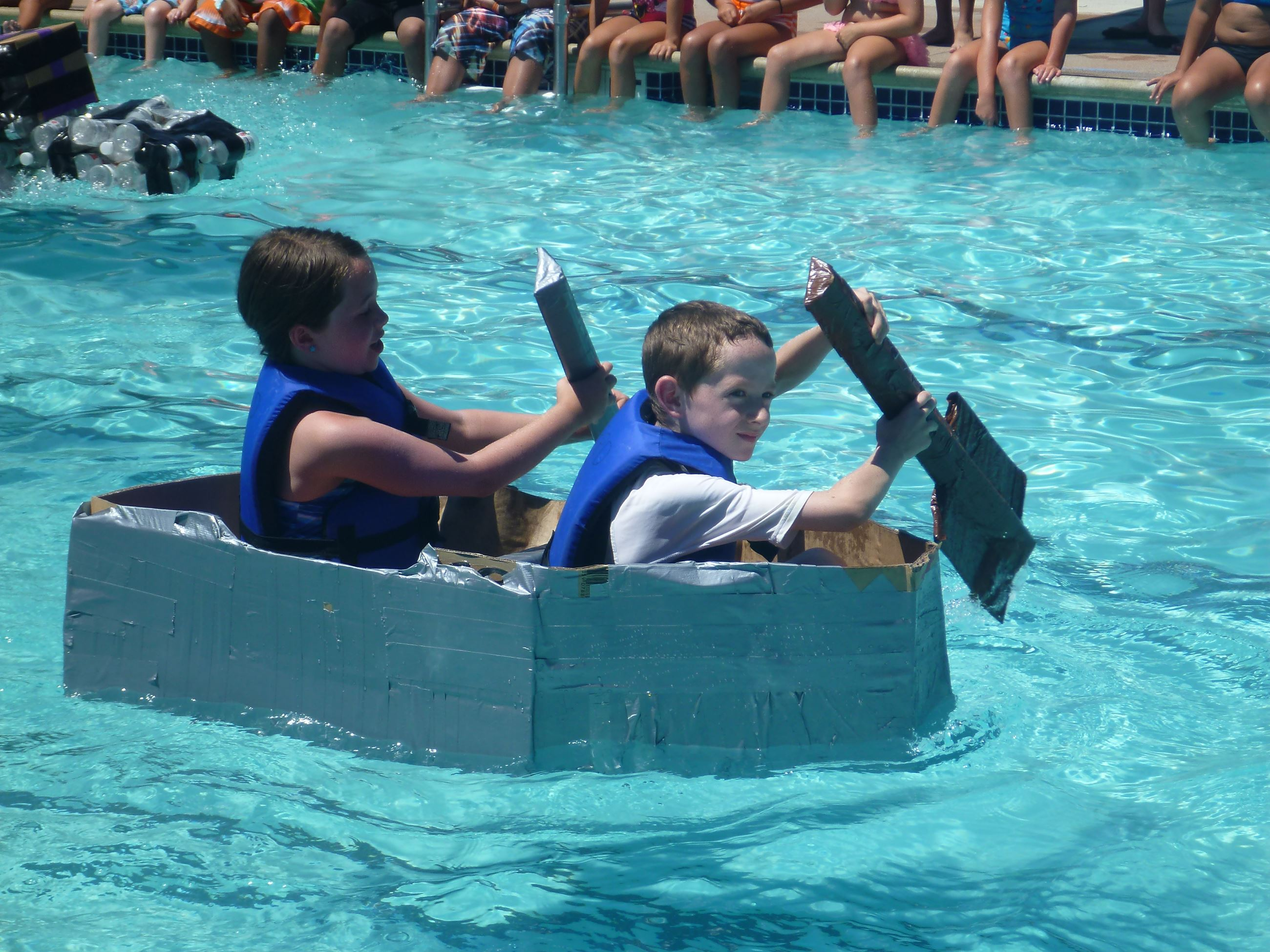 Boys in boat at Derby Day