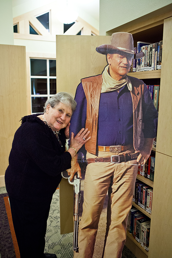 Woman with Cardboard Cut Out of John Wayne