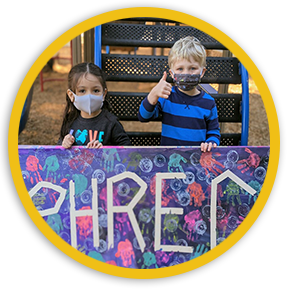 Two Preschoolers with Thumbs Up in front of PHRec sign