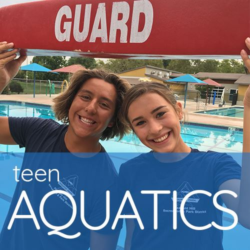 Two Teen Lifeguards Holding Lifeguard Rescue Stick