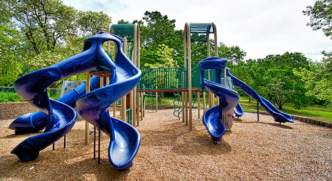 Two blue twisty slides at Brookwood Park