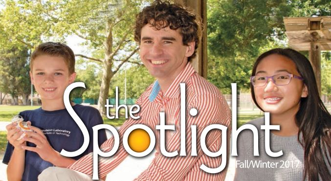 Two teens with Librarian outside with SPOTLIGHT logo