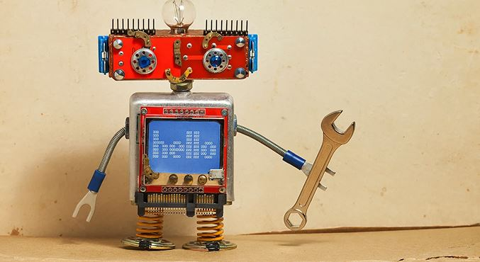 Funny Robot with &#39Hello&#39 on screen holding a wrench